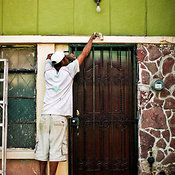 Man painting a green house, Mazatlán, Sinaloa, Mexico
