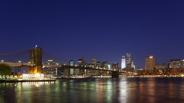 Medium Shot: Brooklyn Bridge Leading To Manhattan During Sunrise (Night to Day)