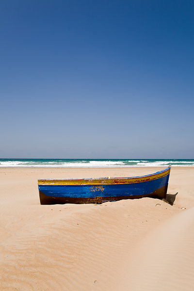 Abandonded boat on the beach
