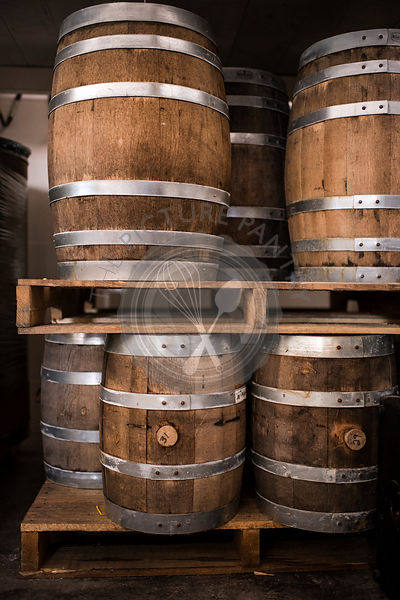 Pallets of beautiful, rustic, wine barrels in multiple sizes.