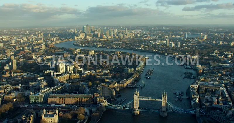 Aerial footage looking along the River Thames from Tower Bridge to Canary Wharf