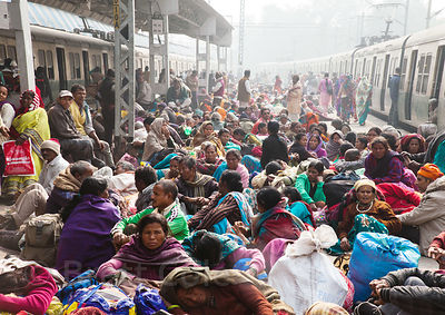 Pilgrims crowd the Sealdah Railway Station platform to travel to Sagar Island, India for the Gangasagar Mela, a Hindu pilgrimage that attracts a million people.
