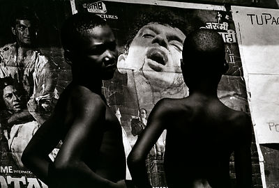 Sierra Leone - Freetown - Two boys in Freetown inspect an Indian cinema poster