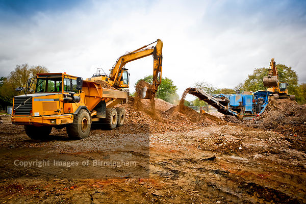 Demolition and ground works on construction site with construction vehicles in operation