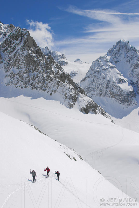 Alpine skiers climbing a slope