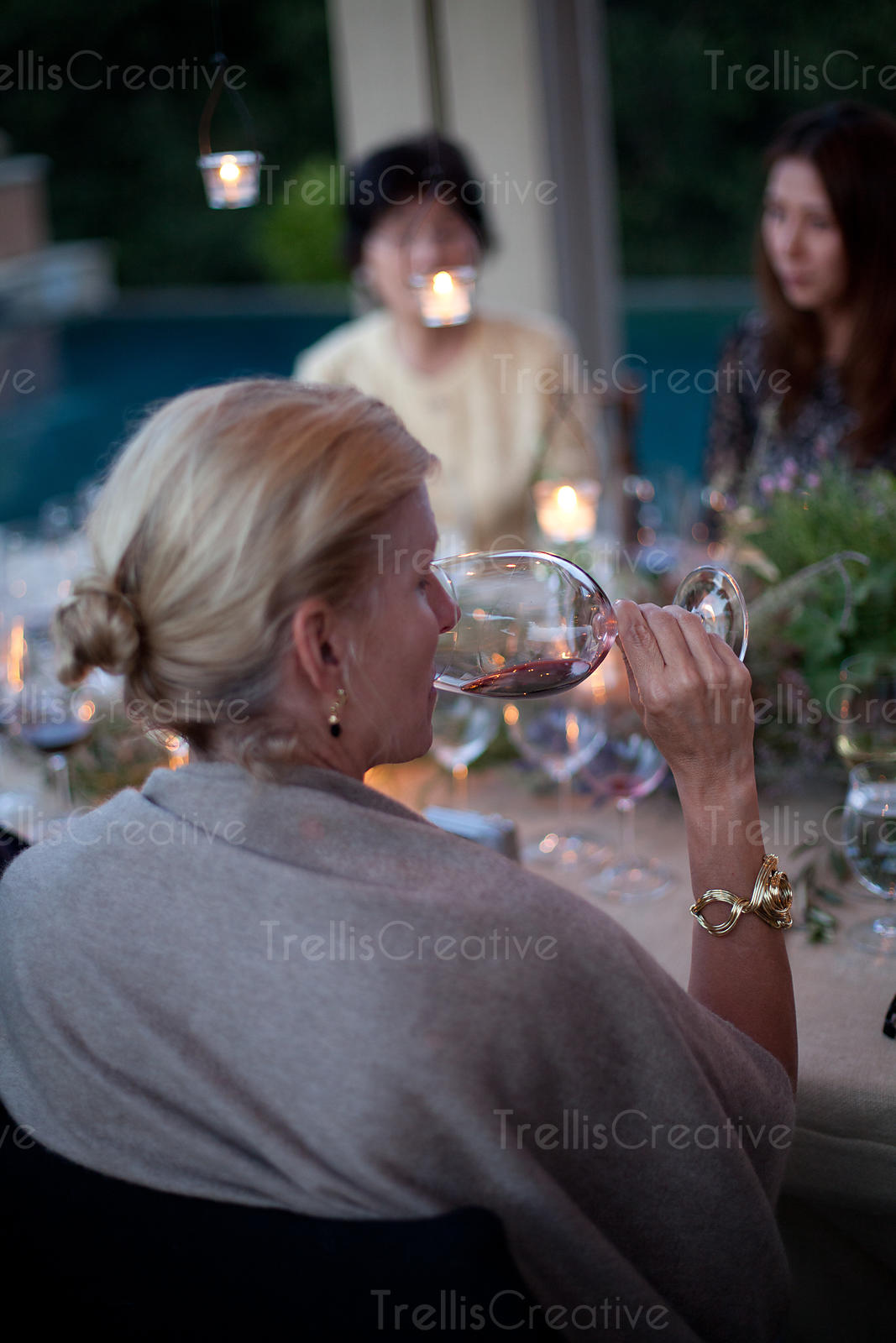 Close-up of a woman drinking red wine