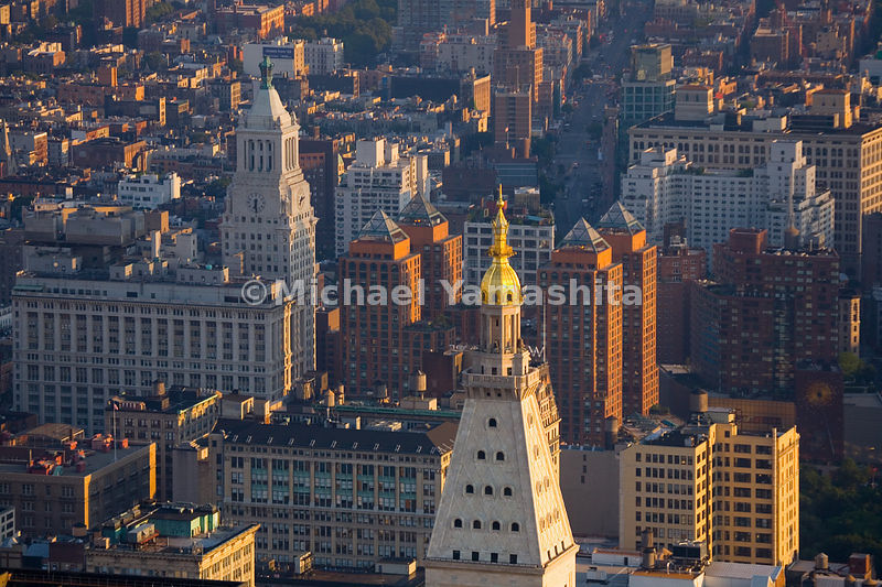 The four pyramids atop Union Square's Zeckendorf Towers echo the four urns on the Consolidated Edison Building's Irving Plaza Tower.  Manhattan, New York City.
