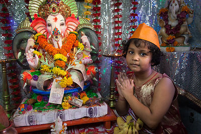 A family performs puja to Ganesh in their home in the Lalbaug neighborhood of Mumbai, India. Lalbaug is the epicenter of the Ganesh Chaturthi festival, which is celebrated throughout the Hindu world.