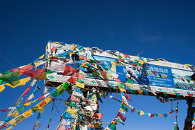 A sign and prayer flags at Lakpa La Pass, 17,121 feet.