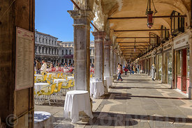 VENICE, ITALY - OCTOBER 23, 2017: A covered walkway on a sunny morning at the Piazza San Marco, in Venice, Italy.