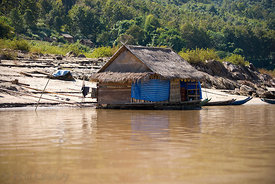 A floating store on the Mekong river Laos