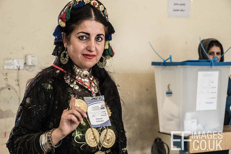 Proudly displaying an ink covered finger, indicating that she has voted in the Kurdish Independence Referendum, this lady is pro independence. Erbil, Iraqi Kurdistan, 25th September 2017