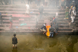 Bodies being prepared for cremation in Pashupatinth Temple on the banks of the Bagmati River. It is a Shiva Hindu site.