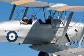Close up of pilot flying a Tiger Moth
