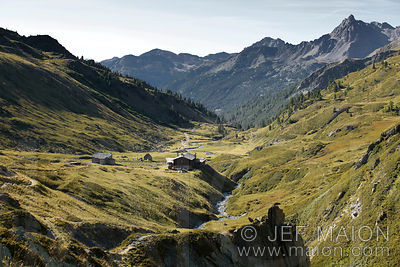 Alpine valley and traditional mountain hut