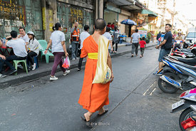 A monk walks by in Chinatown in Bangkok.