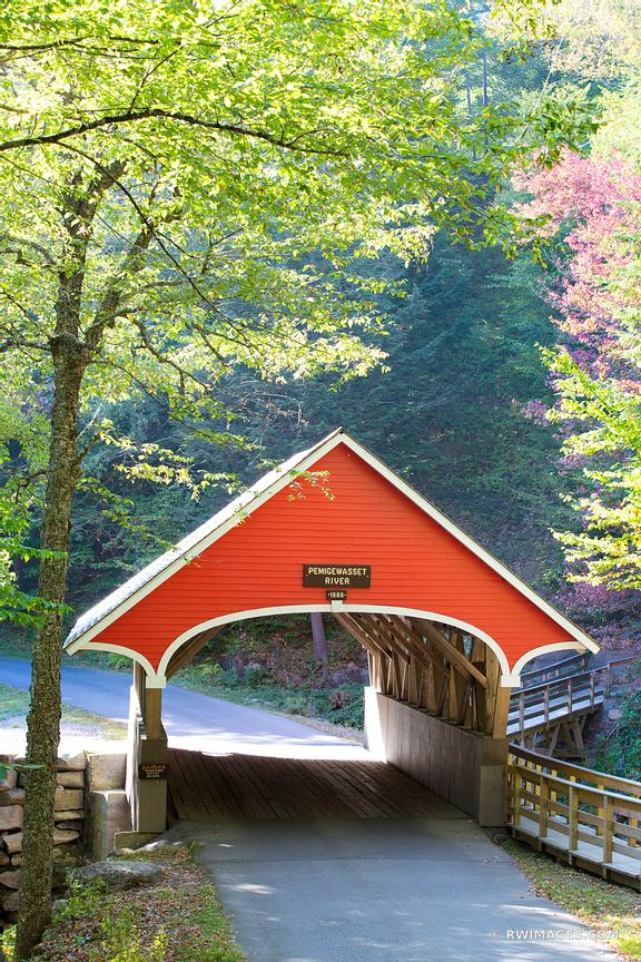 RED COVERED BRIDGE ON PEMIGEWASSET RIVER FRANCONIA NOTCH STATE PARK NEW HAMPSHIRE VERTICAL