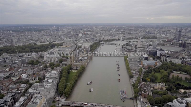 Aerial footage following the River Thames as it flows through Central London