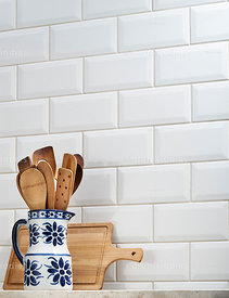 Ceramic jug with wooden spoons and meat board