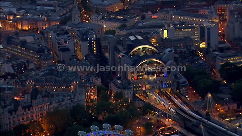 Aerial footage over Charing Cross Station at night, Westminster, London, England, UK