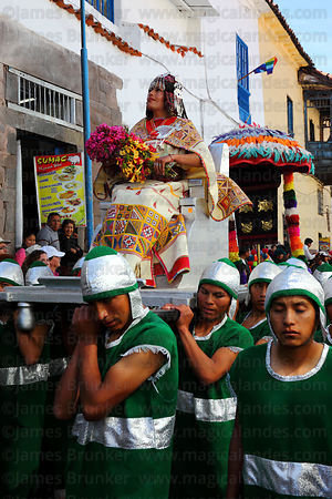 Bearers carry the Inca Queen during processions for Inti Raymi festival , Cusco , Peru