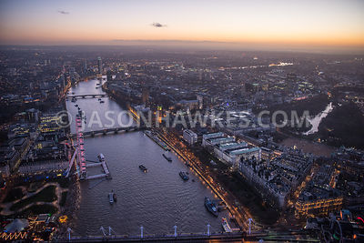Dusk aerial view over River Thames and Westminster, Whitehall, Palace of Westminster, London Eye, London. Ministry of Defence. The Royal Horseguards Hotel. A3211 Victoria Embankment