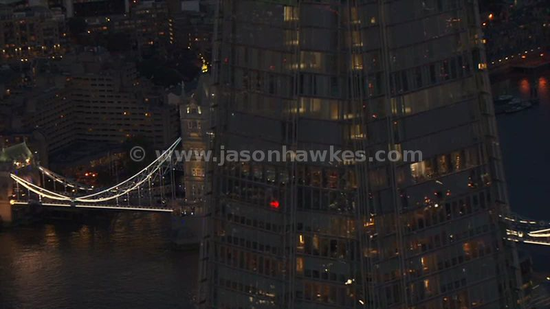 Aerial footage of The Shard and Tower Bridge at night, London