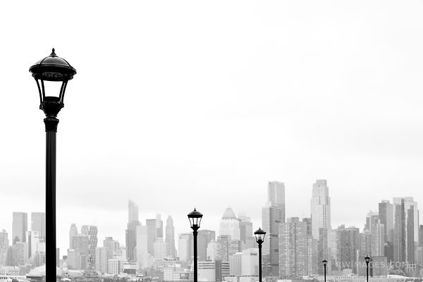 STREET LAMPS MANHATTAN SKYLINE NEW YORK CITY FROM WEEHAWKEN NEW JERSEY BLACK AND WHITE
