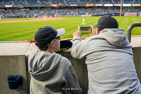 A son and a father at Yankee Stadium in Bronx, NY.