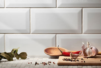 Seasonings on meat board with white ceramic background