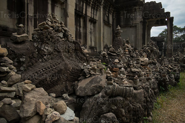 Stacks of broken old statues at Angkor Wat ruins