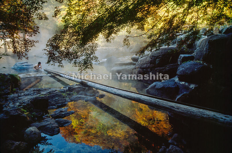 A dreamy haze over Takaragawa hot springs envelops a bather preparing to contemplate the beauty of the autumn foliage.