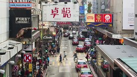 Close Up: Heavy Traffic On Foot & Motor, Downtown Hong Kong