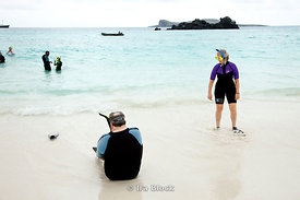 Passengers from the National Geographic Endeavour  prepare to snorkel off the shoreline of Espanola Island.