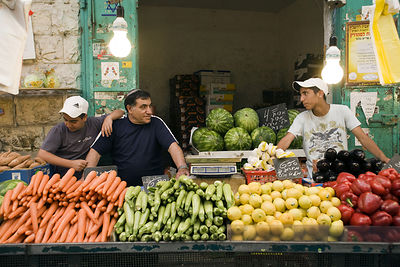Israel - Jerusalem - Yidzack and his sons on his vegetable stall at the Mahane Yahuda Market,
