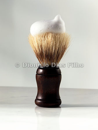 Shaving brush with foam in neutral background