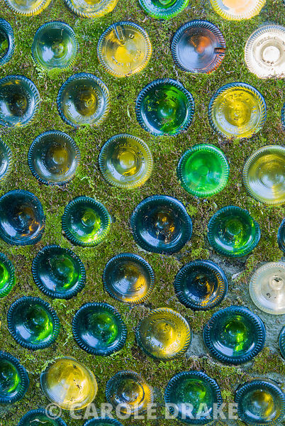 Bases of glass bottles set in cement forming a domed shelter. Westonbury Mill Water Garden, Pembridge, Herefordshire, UK