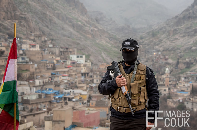 Newroz Security - A Man Armed With A Kalashnikov Oversees Newroz Crowds In Akre