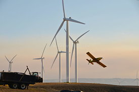 Crop duster and wind towers