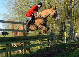 Andrew Osborne MFH jumping a hunt jump in Pickwell