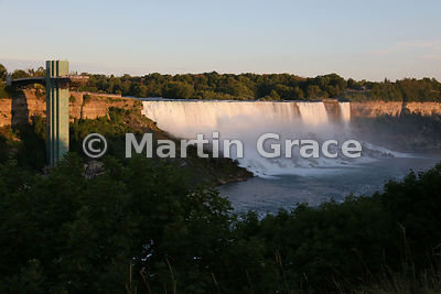 American and Bridal Veil Falls with Goat Island (USA) beyond, in evening sunlight, Niagara Falls, New York, USA, photographed from the Canadian side