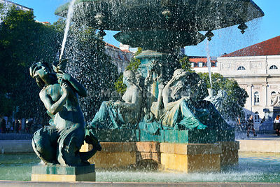 Fountain dating back to 1889, in the centre of the Praca Dom Pedro IV, with mythological statues. Rossio. Lisbon, Portugal