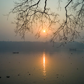 The setting sun over the Hooghley River at Chandannagar