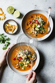 Tortilla soup, with hands