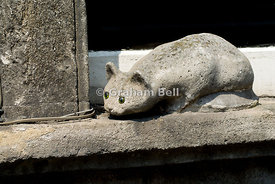 Carved cat on windowsill, Bradord on Avon, Wiltshire, England.