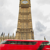 London bus passing Big Ben at the Palace of Westminster, London, England, United Kingdom