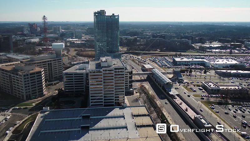 Tysons, Virginia, USA. Trucking shot showing Tysons skyline and Leesburg Pike with the Metro line