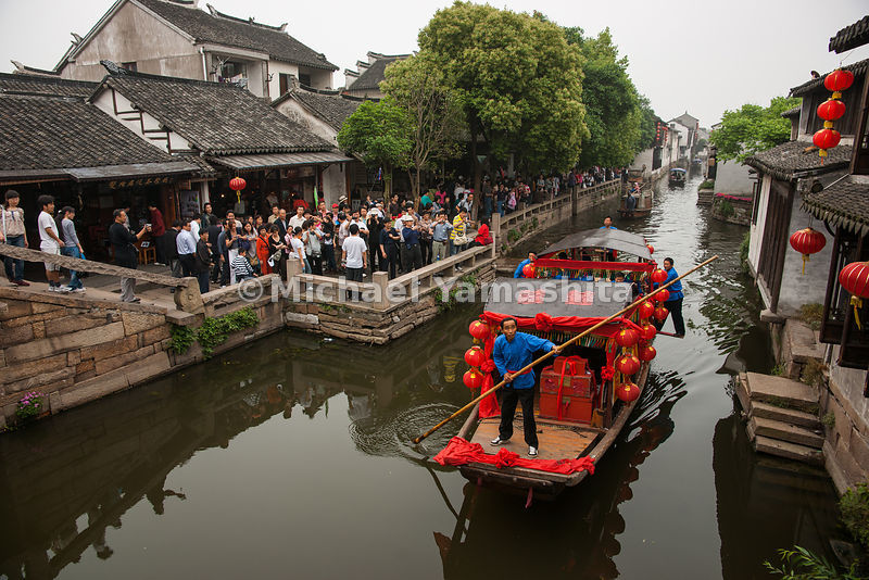 Zhouzhuang—a restored water town that promotes itself as the Venice of the Orient—draws more than 2.5 million sightseers a year.