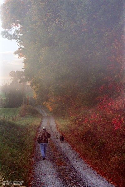 Man and dog, early moring walk