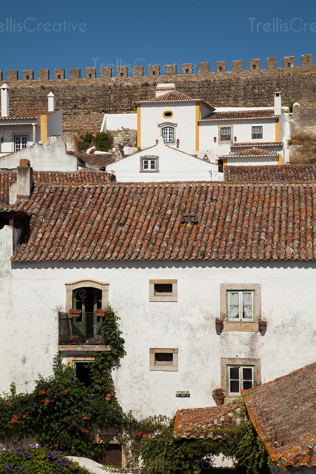 A white washed building in the walled city of Obidos, Portugal.